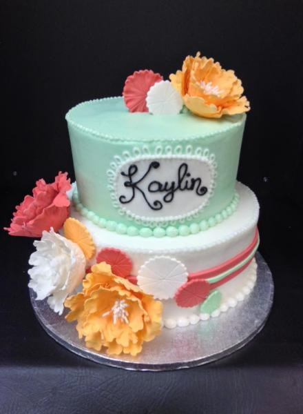 [Image: This sea-foam green and white cake with stunning orange and peach colored flowers is just gorgeous. ]