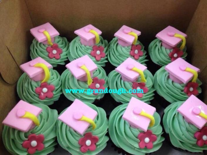 [Image: These tasty cupcakes with green frosting and pink graduation hats would make any graduate proud! ]