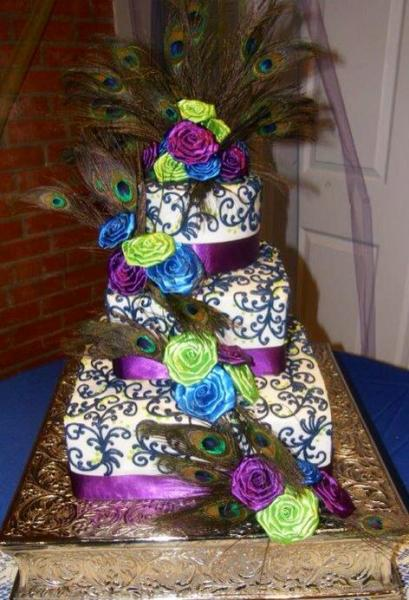 [Image: For birthday parties or bachelorette bashes, this purple and white cake lined with beautiful roses is perfect! ]