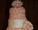 A beautiful combination of Peach Rosette Design along with elegant lace embroidery