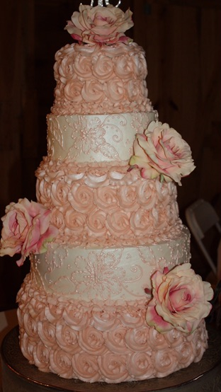 [Image: A beautiful combination of Peach Rosette Design along with elegant lace embroidery ]