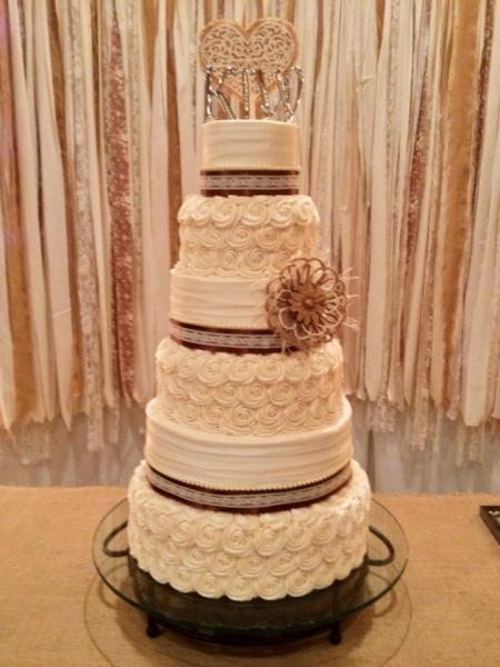 This lovely cream colored cake trimmed in brown lace is the perfect look for any wedding reception!